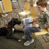 Aaron Porter, 11, reads to Stavros at the Edmond Library in Edmond, Okla., Tuesday, March, 6, 2012. Photo by Sarah Phipps, The Oklahoman