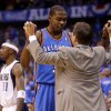 Oklahoma City\'s Kevin Durant (35) celebrates with coach Scott Brooks beside Dallas\' Jason Terry (31) during Game 4 of the first round in the NBA playoffs between the Oklahoma City Thunder and the Dallas Mavericks at American Airlines Center in Dallas, Saturday, May 5, 2012. Oklahoma City won 103-97. Photo by Bryan Terry, The Oklahoman