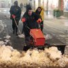 Men shovel snow from a walkway in Times Square Wednesday, Nov. 7, 2012, in New York. Coastal residents of New York and New Jersey faced new warnings to evacuate their homes and airlines canceled hundreds of flights as a new storm arrived Wednesday, only a week after Superstorm Sandy left dozens dead and millions without power. (AP Photo/Frank Franklin II)