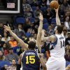 Photo - Minnesota Timberwolves' Nikola Pekovic, of Montenegro, releases a shot over Utah Jazz's Enes Kanter, of Turkey, during the first quarter of an NBA basketball game, Saturday, Jan. 18, 2014, in Minneapolis. (AP Photo/Jim Mone)