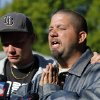 Jeremy Bush, right, prays as he speaks to the media as demolition continues at the home of his brother, Jeff Bush, Monday, March 4, 2013 in Seffner, Fla. A sinkhole opened up underneath the house late Thursday, Feb. 28, 2013, swallowing Jeff Bush, 37. The 20-foot-wide opening of the sinkhole was almost covered by the house, and rescuers said there were no signs of life since the hole opened Thursday night. (AP Photo/Scott Iskowitz)