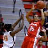 Carl Albert\'s Gioya Carter, right, shoots the ball beside Putnam City\'s TaiZhon McClurkin during their girls high school basketball game at Carl ALbert in Midwest City, Okla., Friday, Jan. 25, 2013. Photo by Bryan Terry, The Oklahoman