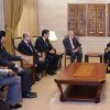 Photo -   In this photo released by the Syrian official news agency SANA, Syrian President Bashar Assad, right, meets with the U.N.-Arab League envoy Lakhdar Brahimi, second right, in Damascus, Syria, Saturday Sept. 15, 2012. The new international envoy tasked with ending Syria's civil war says the country's conflict is a threat to world peace. (AP Photo/SANA)