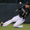 Colorado Rockies right fielder Brandon Barnes catches a fly ball by Miami Marlins\' Casey McGehee in the fifth inning of a baseball game in Denver on Saturday, Aug. 23, 2014..(AP Photo/David Zalubowski)