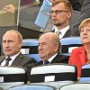 Russia\'s President Vladimir Putin, left, FIFA President Sepp Blatter, center, and Germany\'s Chancellor Angela Merkel, right, watch the opening ceremony of the World Cup final soccer match between Germany and Argentina at Maracana Stadium in Rio de Janeiro, Brazil, Sunday, July 13, 2014. (AP Photo/Martin Meissner)