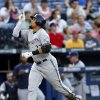 Milwaukee Brewers center fielder Carlos Gomez (27) reacts as he rounds the bases after hitting a two-run home run in the fourth inning of a baseball game Wednesday, May 21, 2014 in Atlanta. (AP Photo/John Bazemore)