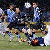 Photo - Ulsan Hyundai's Rafael, bottom right, attempts to score a goal against Kawasaki Frontale's goalkeeper Yohei Nishibe during their group stage soccer match of the AFC Champions League in Kawasaki,  near Tokyo, Tuesday, April 22, 2014. (AP Photo/Shuji Kajiyama)