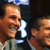 Photo - Baltimore Raven's owner Steve Bisciotti, left, and head coach John Harbaugh smile during a news conference Wednesday, Jan 8, 2014 in Owings Mills, Md.(AP Photo/Gail Burton)