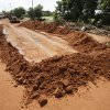 Edmond city workers scoop hundreds of tons of sand off of Danforth Rd. just west of Douglas in Edmond, OK, after yesterday\'s torential rains deposited the sand more than three feet deep across the road, Tuesday, June 15, 2010. By Paul Hellstern, The Oklahoman