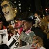 Demonstrators chant during a protest march while using a puppet in the likeness of Mitt Romney, Thursday, Aug. 30, 2012, in Tampa, Fla. Protestors gathered in Tampa to march in demonstration against the Republican National Convention. (AP Photo/Dave Martin) ORG XMIT: XCVN138