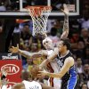 Photo - Orlando Magic guard Beno Udrih of Slovenia, right, shoots against Miami Heat guard Ray Allen (34) and forward Chris Andersen, center rear, during the first half of an NBA basketball game, Wednesday, April 17, 2013 in Miami. (AP Photo/Wilfredo Lee)