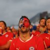 Photo - Soccer fans watch a live broadcast of the group B World Cup match between Chile and Spain, inside the FIFA Fan Fest area on Copacabana beach, in Rio de Janeiro, Brazil, Wednesday, June 18, 2014. Chile defeated Spain, the defending champs, 2-0. (AP Photo/Leo Correa)