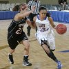 Millwood\'s Teanna Reid (10) drives past Verdigris\' Baileigh O\'Dell (25) during the 3A girls quarterfinals game between Millwood High School and Verdigris High School at the State Fair Arena on Thursday, March 7, 2013, in Oklahoma City, Okla. Photo by Chris Landsberger, The Oklahoman