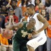 Oklahoma State \'s Le\'Bryan Nash (2) fouls South Florida Bulls\' Martino Brock (0) during the college basketball game between Oklahoma State University (OSU) and the University of South Florida (USF) on Wednesday , Dec. 5, 2012, in Stillwater, Okla. Photo by Chris Landsberger, The Oklahoman