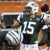 Photo -   New York Jets quarterback Tim Tebow passes against the Cincinnati Bengals in the first half of an NFL preseason football game, Friday, Aug. 10, 2012, in Cincinnati. (AP Photo/Tom Uhlman)