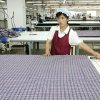 In this Sept. 21, 2012 photo, a North Korean worker prepares to measure fabric at the South Korean-run ShinWon Corp. garment factory inside the Kaesong industrial complex in Kaesong, North Korea. On Wednesday, April 3, 2013, North Korea refused entry to South Koreans trying to cross the Demilitarized Zone to get to their jobs managing factories in the North Korean city of Kaesong. Pyongyang had threatened in recent days to close the border in anger over South Korea\'s support of U.N. sanctions punishing North Korea for conducting a nuclear test in February. (AP Photo/Jean H. Lee)