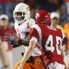OSU\'s Joseph Randle tries to get past Louisiana-Lafayette\'s Brett Baer during the football game between the University of Louisiana-Lafayette and Oklahoma State University at Cajun Field in Lafayette, La., Friday, October 8, 2010. Photo by Bryan Terry, The Oklahoman