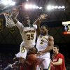 Photo - Baylor's Taurean Prince (35) and Rico Gathers (2) jumps over Texas Tech  forward Jaye Crockett (30) during the first half of an NCAA college basketball game, Saturday, March, 1, 2014, in Waco, Texas. (AP Photo/Waco Tribune Herald, Michael Bancale)