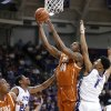 Photo - Texas center Prince Ibeh (44) takes a shot while forward Jonathan Holmes (10) watches and TCU guard Jarvis Ray (22) and center Karviar Shepherd (1) defend during the first half of an NCAA college basketball game Tuesday, Feb. 4, 2014, in Fort Worth, Texas. (AP Photo/Sharon Ellman)