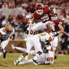 Trey Millard (33) leaps over defenders during the second half of the college football game between the University of Oklahoma Sooners (OU) and Florida A&M Rattlers at Gaylord Family—Oklahoma Memorial Stadium in Norman, Okla., Saturday, Sept. 8, 2012. Photo by Steve Sisney, The Oklahoman