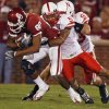 Oklahoma\'s Adron Tennell (80) is drug down by Nebraska\'s Anthony West (5) during the first half of the college football game between the University of Oklahoma Sooners (OU) and the University of Nebraska Huskers (NU) at the Gaylord Family Memorial Stadium, on Saturday, Nov. 1, 2008, in Norman, Okla. BY STEVE SISNEY, THE OKLAHOMAN