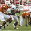Texas\' Keenan Robinson (1) tries to stop Oklahoma\'s Dominique Whaley (8) during the Red River Rivalry college football game between the University of Oklahoma Sooners (OU) and the University of Texas Longhorns (UT) at the Cotton Bowl in Dallas, Saturday, Oct. 8, 2011. Photo by Chris Landsberger, The Oklahoman