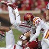 Oklahoma\'s Trevor Knight (9) is upended by Iowa State\'s Jacques Washington (5) and Nigel Tribune (34) during the college football game between the University of Oklahoma Sooners (OU) and the Iowa State University Cyclones (ISU) at Gaylord Family-Oklahoma Memorial Stadium in Norman, Okla. on Saturday, Nov. 16, 2013. Photo by Chris Landsberger, The Oklahoman
