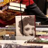 A sale volunteer tidies a table and fills in empty spots with additional books. Several thousand bibliophiles and bargain hunters crowded into Oklahoma Expo Hall at State Fair Park on Saturday, Feb. 23, 2013, in a quest to find reading material at deeply discounted prices. Friends of the Metropolitan Library System is holding their much-anticipated annual book sale this weekend. The sale continues Sunday from 9 a.m. to 5:30 p.m. Photo by Jim Beckel, The Oklahoman