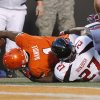 Oklahoma State\'s Joseph Randle (1) is brought down short of the end zone by Texas Tech\'s Zach Winbush (27) during a college football game between Oklahoma State University (OSU) and Texas Tech University (TTU) at Boone Pickens Stadium in Stillwater, Okla., Saturday, Nov. 17, 2012. Photo by Bryan Terry, The Oklahoman