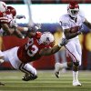 Photo - Oklahoma's DeMarco Murray (7) gets past Nebraska's Ndamukong Suh (93) during the first half of the college football game between the University of Oklahoma Sooners (OU) and the University of Nebraska Cornhuskers (NU) on Saturday, Nov. 7, 2009, in Lincoln, Neb.  PHOTO BY CHRIS LANDSBERGER, THE OKLAHOMAN