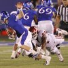 Oklahoma\'s Frank Alexander (84) dives for Kansas quarterback Jordan Webb (2) during the college football game between the University of Oklahoma Sooners (OU) and the University of Kansas Jayhawks (KU) on Saturday, Oct. 15, 2011. in Lawrence, Kan. Photo by Chris Landsberger, The Oklahoman