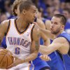 Oklahoma City\'s Eric Maynor (6) looks for room past Jose Barea (11) of Dallas during game 3 of the Western Conference Finals of the NBA basketball playoffs between the Dallas Mavericks and the Oklahoma City Thunder at the OKC Arena in downtown Oklahoma City, Saturday, May 21, 2011. Photo by Chris Landsberger, The Oklahoman