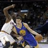 Golden State Warriors\' Klay Thompson (11) drives on Cleveland Cavaliers\' Dion Waiters during the first quarter of an NBA basketball game Tuesday, Jan. 29, 2013, in Cleveland. (AP Photo/Mark Duncan)