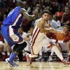 Oklahoma\'s Frank Booker (1) drives against Louisiana Tech\'s Isaiah Massey (10) during a men\'s college basketball game between the University of Oklahoma Sooners (OU) and the Louisiana Tech Bulldogs at Lloyd Noble Center in Norman, Okla., Monday, Dec. 30, 2013. Louisiana Tech won 102-98 in overtime. Photo by Nate Billings, The Oklahoman