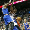 Photo - Atlanta Hawks forward Elton Brand (42) is fouled as he goes to the basket against New York Knicks forward Amar'e Stoudemire (1) in the first half of an NBA basketball game Saturday, Feb. 22, 2014, in Atlanta. (AP Photo/John Bazemore)
