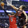 Photo - Miami Heat forward LeBron James (6) drives to the basket against Chicago Bulls center Joakim Noah during the first half of an NBA basketball game in Chicago, Thursday, Feb. 21, 2013. (AP Photo/Nam Y. Huh)