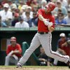 Washington Nationals\' Bryce Harper hits a two-run double during the third inning of an exhibition spring training baseball game against the Miami Marlins, Wednesday, March 20, 2013, in Jupiter, Fla. The Nationals won 7-5. (AP Photo/Jeff Roberson)