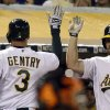 Photo - Oakland Athletics' manager Bob Melvin, left, and Brandon Moss (37) congratulate Craig Gentry (3) after Gentry scored against the San Francisco Giants in the fifth inning of a baseball game Monday, July 7, 2014, in Oakland, Calif. Gentry scored on a ground out hit by John Jaso. (AP Photo/Ben Margot)
