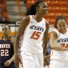 OSU\'s Toni Young (15) and Carissa Crutchfield (24) smile after a play as Pepperdine\'s Shay Cooney-Williams (22) watches during a first-round NIT women\'s college basketball game between Oklahoma State University (OSU) and Pepperdine at Gallagher-Iba Arena in Stillwater, Okla., Wednesday, March 16, 2011. Photo by Bryan Terry, The Oklahoman
