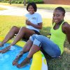 Courtney Jefferson, left, and Michae Manuel, both from McAlester, cool their feet in a wading pool at the