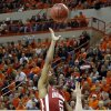 Oklahoma\'s Je\'lon Hornbeak (5) shoots over Oklahoma State\'s Phil Forte (13) during the Bedlam men\'s college basketball game between the Oklahoma State University Cowboys and the University of Oklahoma Sooners at Gallagher-Iba Arena in Stillwater, Okla., Saturday, Feb. 16, 2013. Photo by Sarah Phipps, The Oklahoman