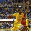 West Virginia\'s Aaric Murray (24) drives by Radford\'s Jalen Carethers, right, during the second half of an NCAA college basketball game at WVU Coliseum in Morgantown, W.Va., Saturday, Dec. 22, 2012. West Virginia defeated Radford 72-62. (AP Photo/David Smith)