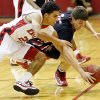 Del City\'s Brett Cannon (22) and Mustang\'s Geoff Hightower (35) chase a loose ball during a high school basketball between Del City and Mustang at Del City High School in Del City, Okla., Thursday, Dec. 27, 2012. Photo by Nate Billings, The Oklahoman