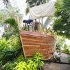 Workers install a pirate ship from the