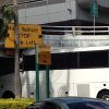 A bus is lodged into an overpass at the Miami International Airport on Saturday, Dec. 1, 2012. The vehicle was carrying over 30 people when it crashed into the structure. Authorities say buses typically are routed through the departures area, which has a higher clearance. (AP Photo/Suzette Laboy)