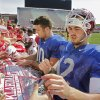 Quarterbacks Blake Bell (10) and Landry Jones (12) sign autographs after the University of Oklahoma Sooner\'s (OU) Spring Football game at Gaylord Family-Oklahoma Memorial Stadium on Saturday, April 16, 2011, in Norman, Okla. Photo by Steve Sisney, The Oklahoman