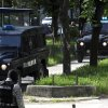 Police transport the suspects, arrested in relation to the murder of five ethnic Macedonian fishermen last month, to a court in Skopje, Macedonia, Wednesday, May 2, 2012. Macedonian authorities have arrested 20 people, all radical Islamists, suspected in the murder of five Macedonian fishermen last month that fueled ethnic tensions in this tiny Balkan country. The suspects have been charged with terrorism. (AP Photo/Boris Grdanoski)