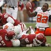 Oklahoma State\'s Dantrell Savage (22) gets out of the pile without his helmet during the first half of the college football game between the University of Oklahoma Sooners (OU) and the Oklahoma State University Cowboys (OSU) at the Gaylord Family-Memorial Stadium on Saturday, Nov. 24, 2007, in Norman, Okla. Photo By STEVE SISNEY, The Oklahoman