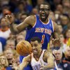Oklahoma City\'s Thabo Sefolosha (25) chases a loose ball in front of New York\'s Amar\'e Stoudemire (1) during an NBA basketball game between the New York Knicks and the Oklahoma City Thunder at Chesapeake Energy Arena in Oklahoma City, Sunday, Feb. 9, 2014. Oklahoma City won, 112-100. Photo by Nate Billings, The Oklahoman