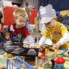 Two-year-old Cooper Young (left) and three-year-old Ethin Scott play with some wooden trains during the annual Oklahoma City Train Show in the Travel and Transportation Building at State Fair Park in Oklahoma City, OK, Saturday, Dec. 4, 2010. By Paul Hellstern, The Oklahoman